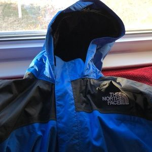 YOUTH xl blue and black North Face rain jacket